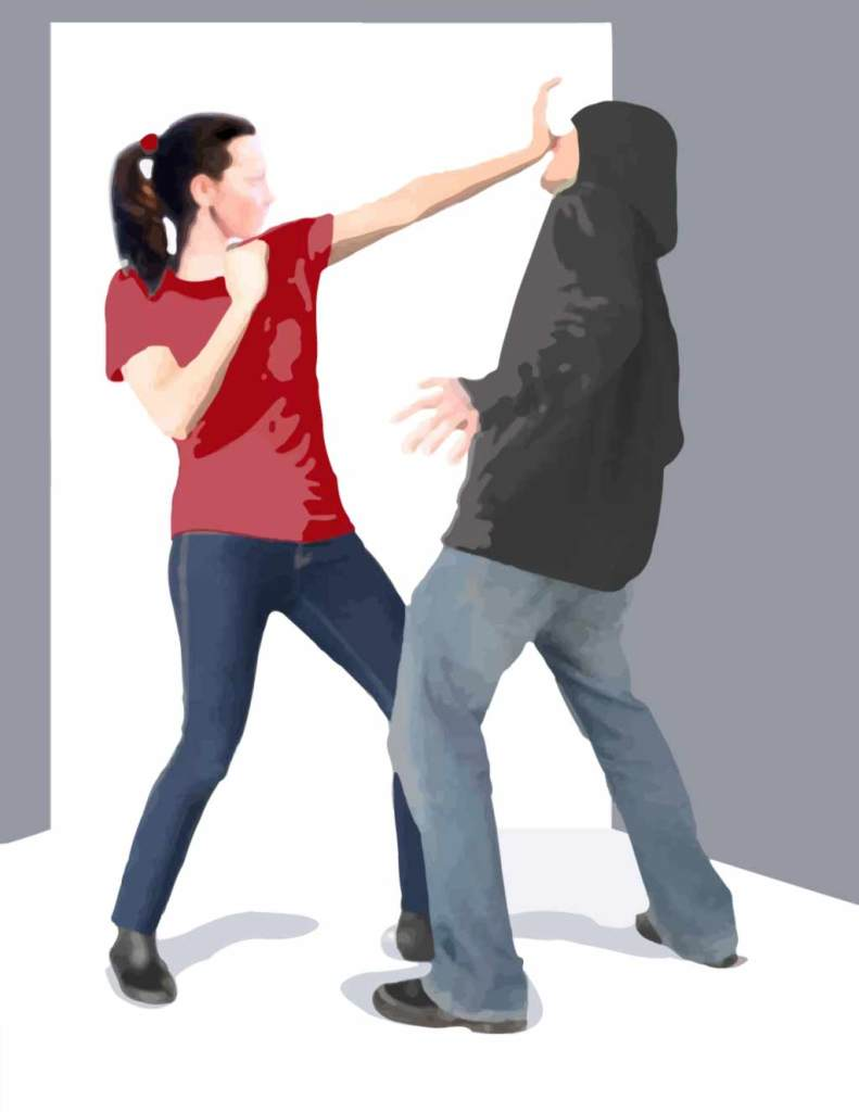 Woman defending herself against an attacker