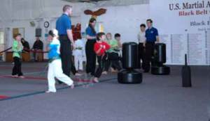 kicking drill in the Kung Fu Kids Children's Kung Fu Class at US Martial Arts Academy, Ltd in Timonium, Maryland, www.usmaltd.com, 410-561-9882. ©2015 Maricar Jakubowski All rights reserved. No usage allowed in any form without the written consent of the photographer.