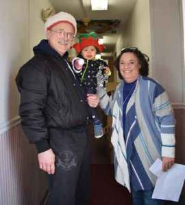 Shi Fu Paul Jakubowski and his elf granddaughter of US Martial Arts Academy, Ltd delivered holiday gifts collected for St. Vincent's Villa 2017 Season of Wonder