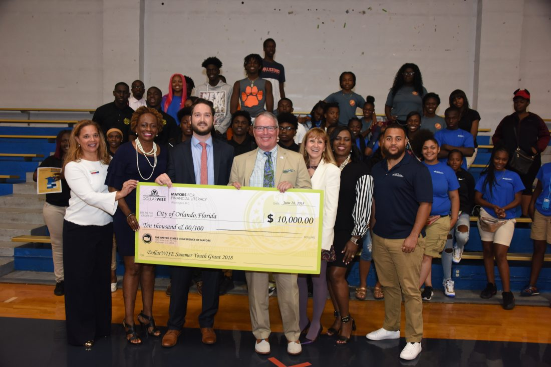 Orlando Mayor Buddy Dyer is awarded a 2018 DollarWise Grant to support his City's Parramore Kidz Zone Summer Youth Employment Program