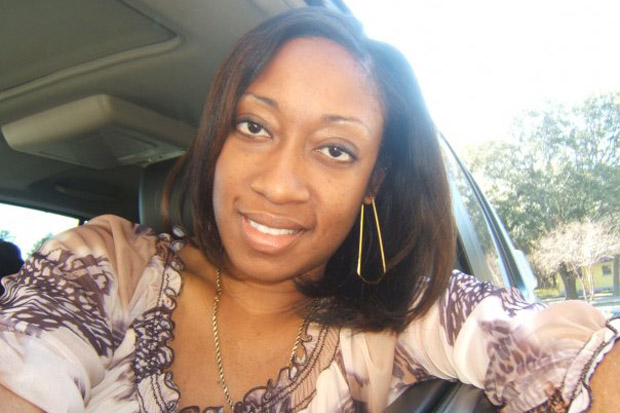 This undated family photo provided by Lincoln B. Alexander shows, Marissa Alexander in her car in Tampa, Fla. Alexander had never been arrested before she fired a bullet at a wall one day in 2010 to scare off her husband when she felt he was threatening her. Nobody got hurt, but this month a northeast Florida judge was bound by state law to sentence her to 20 years in prison. (Lincoln B. Alexander/AP)