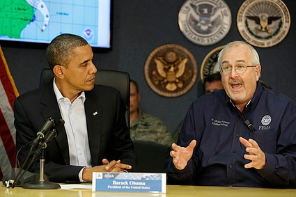 President Barack Obama listens as Federal Emergency Management Agency administrator Craig Fugate speaks to the media about Hurricane Sandy at FEMA Headquarters in Washington.