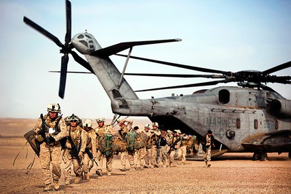 U.S. Marines and Afghan police in Afghanistan. A new study estimates the wars in Iraq and Afghanistan will cost $4 to $6 trillion.