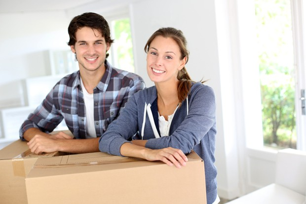 Young couple moving in new home.