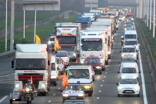 Truck drivers slow down traffic on the highway A1 on Oct. 18, 2010, near Lille, France. American truckers plan a similar protest beginning Friday, according to organizers.<br />