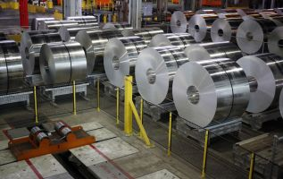 Alcoa's profit beat fueled by rising alumina prices, shares rise 3