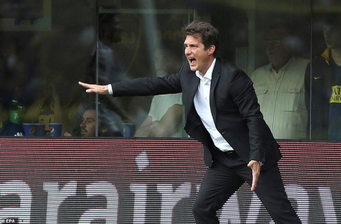 Boca Juniors' head coach Guillermo Barros Schellotto screams instructions to his players from the touchline