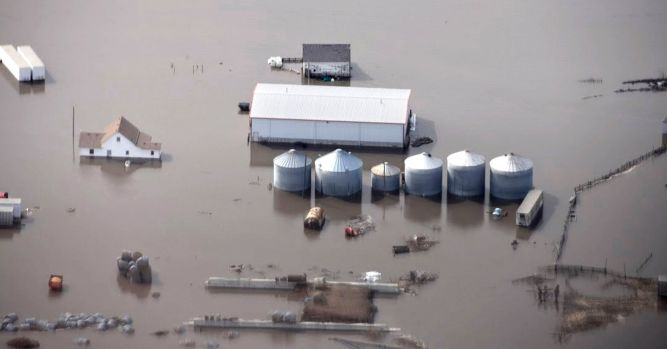 DowDupont cuts its sales forecast as Midwest floods hit its agri division 2