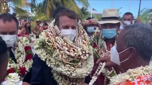Macron turns into human wreath after arriving at remote Pacific island 1