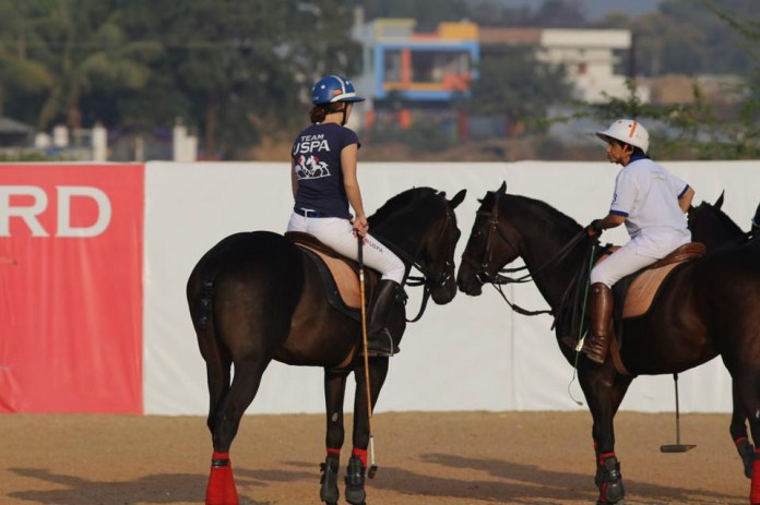 Team USPA's Anna Winslow discusses strategy with Sonia Jabbar of Delhi, India.
