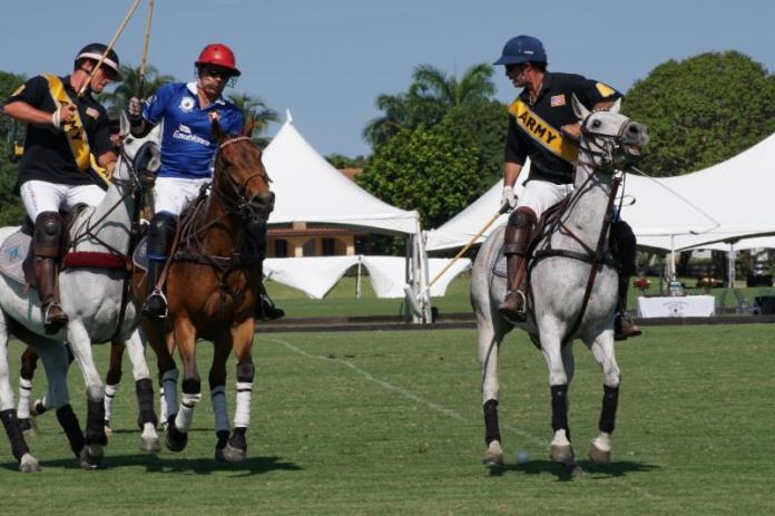 Army teammates Jesse Bray and Juan Bollini defends Markus Graff of Grand Champions. Photo courtesy ChukkerTV.