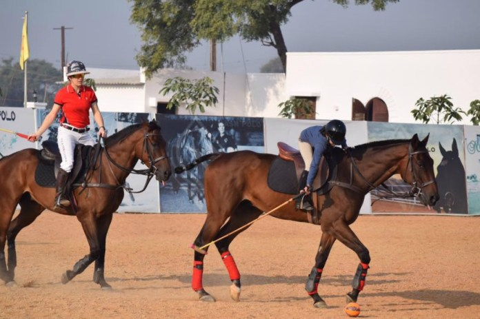 Team USPA member Carly Persano coaches Nasr Polo's youngest member Aparna Dhulipala.
