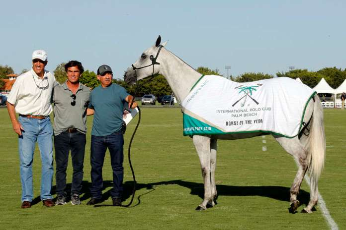 International Polo Club Horse of the Year: Macarena, owned and played by Mariano Gonzalez, presented by USPA Chairman Chip Campbell, pictured with Lalo Ugarte.