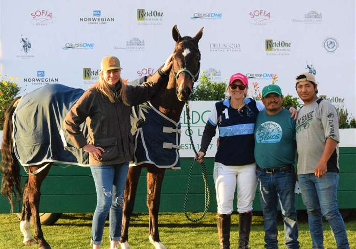 A Flight Best Playing Pony, Taxi, presented by Shelley Geiler, pictured with Margarito Flores Luna and his son Luis. ©Kerri & Hope Kerley