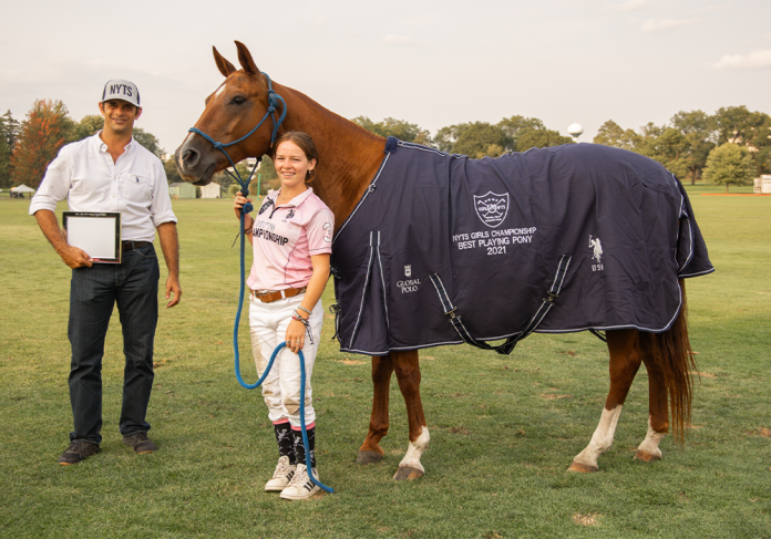 Best Playing Pony, Sagebrush, played and owned by Reagan Leitner. Presented by USPA Executive Director of Services Carlucho Arellano. ©KaileRoos