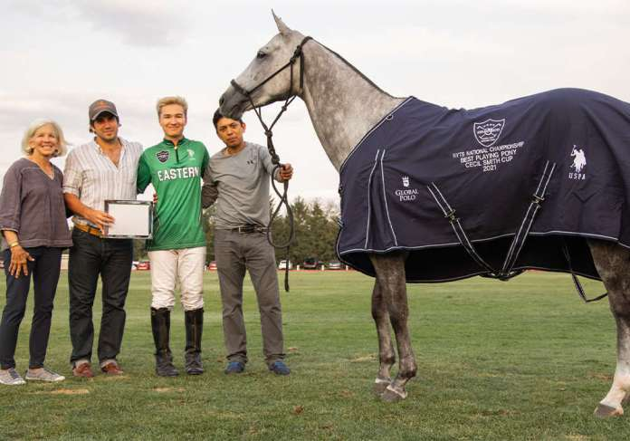 Best Playing Pony Soda, played by Winston Painter and owned by Mariano Obregon Jr. Presented by NYTS Chair Chrys Beal. Pictured with Marco Tulio Esquivel. ©Kaile Roos