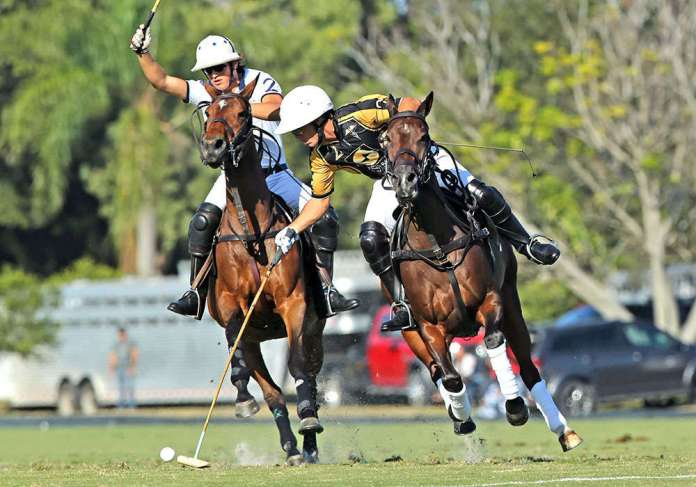 Palm Beach Equine's Robi Bilbao turning in front of Lucas Escobar in the 2021 Ylvisaker Cup ©Alex Pacheco.