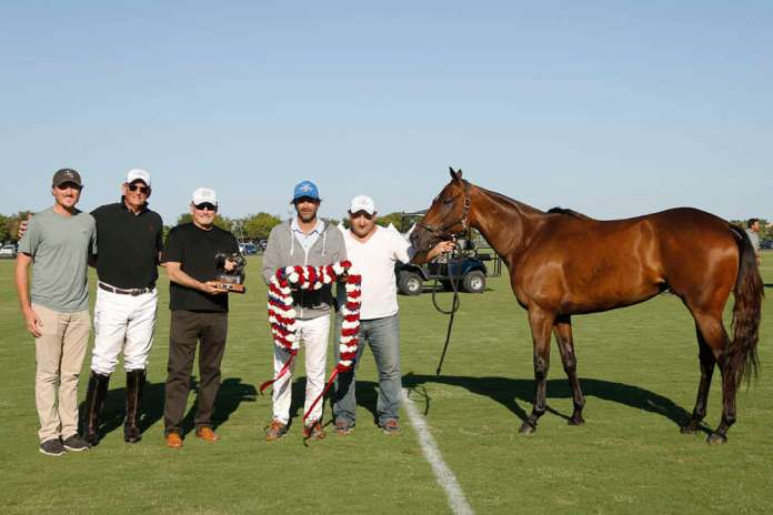 International Polo Club Best American-Bred Horse of the U.S. Open: Tanita, played by Adolfo Cambiaso, owned by J5 Equestrian, pictured with Rob Jornayvaz, Bob Jornayvaz, USPA Umpires, LLC Chairman Britt Baker and ____.