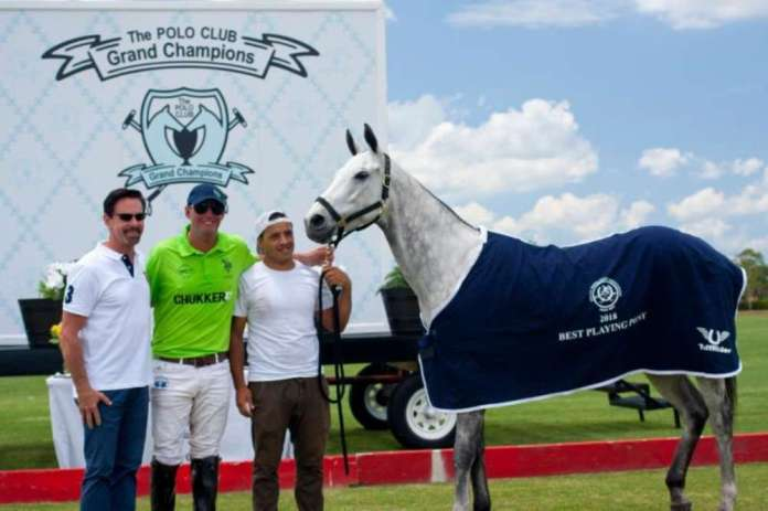 Best Playing Pony Cupid, owned and played by Julio Gracida. Pictured with awards presenter USPA CEO Bob Puetz.
