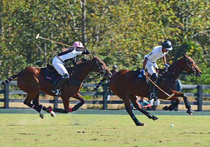 SIG's Malia Bryan and Derry Heir's Alan Martinez battle it out on the field.