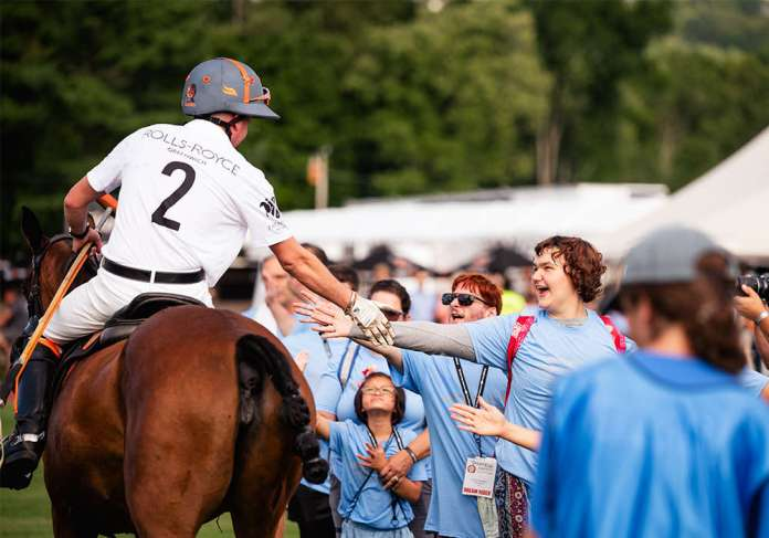 Rolls Royce and Lamborghini receive high fives and support from the Dream Riders.