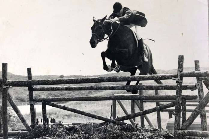 "Judith Baker and Nobeark, who she bought at a racetrack in Mexico, made herself and competed in England, shown jumping a 5'3"" oxer fence."