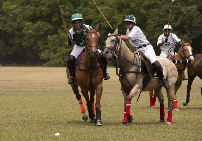 JD Polo's Ekaterina Kotova prepares to ride off Matille Drury of Forty Flowers.