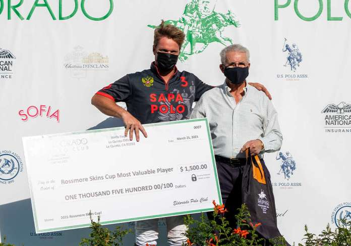 Most Valuable Player Marcos Alberdi with Eldorado Polo Club President Mike Ward.