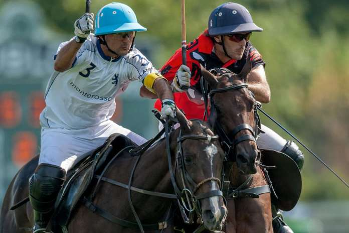 Postage Stamp Farm's Lerin Zubiaurre and Cubi Toccalino of Monterosso battle for possession.