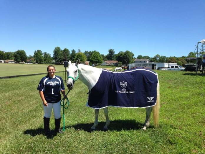 St. Louis Polo Club Best Playing Pony Sopressa, pictured with Josie Gallegos.