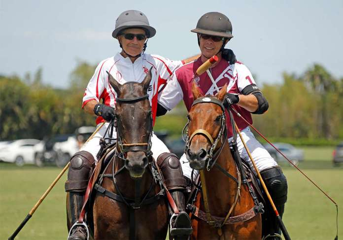 Scone's David Paradice riding off the field with Pilot's Curtis Pilot after a hard-fought U.S. Open Polo Championship® Semfinal.