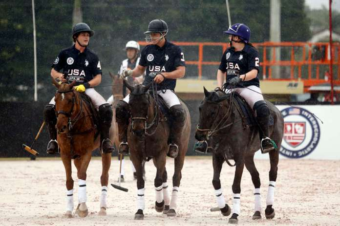 The victorious USA team (Liam Lott, Christian Aycinena and Demitra Hajimihalis) walk out of the arena on a rainy day in Wellington.