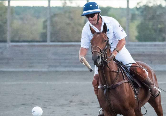 USPA Armed Force's Alex Jenkins hits the ball in the air.