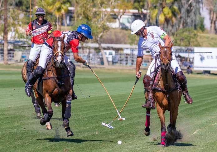 Sapa Polo's Jimmy Wright reaches for hook on Antelope's Santiago Trotz.
