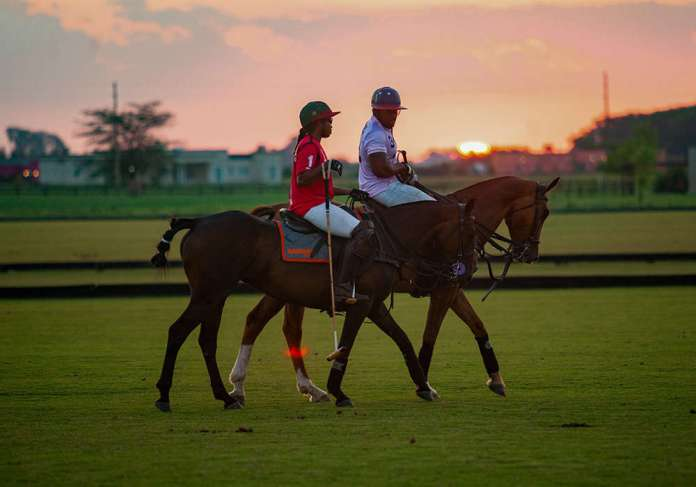 Johnson and his wife Christine enjoying quality time on the polo field.