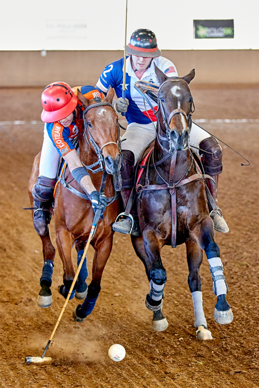 Legends Polo Club's August Scherer making a play on the ball while being ridden off by Texas Military Polo's Wyatt Myr.
