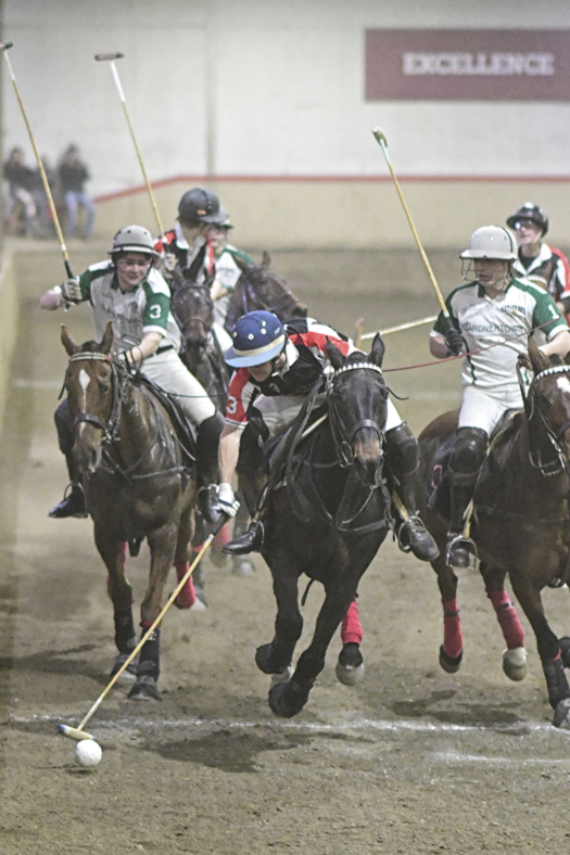 Parker Pearce of Maryland Polo Club on the ball with Gardnertown Polo Club's Matteo Chaux and John Denker hustling to defend during the Open National Interscholastic Championship Final.