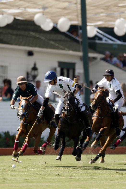 Viana and Nochebuena lead the field at full speed during the 2018 Vic Graber Memorial at Santa Barbara Polo & Racquet Club.
