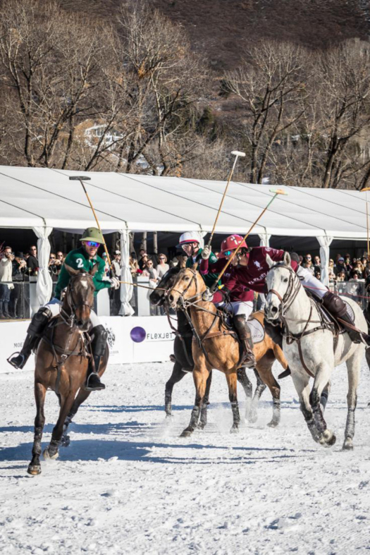 Players battle for the ball in the final of the St. Regis World Snow Polo Championship.