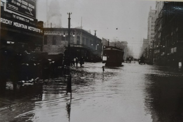 A photo of the flooding in downtown Denver after the Castlewood Dam broke. (Credit: Sherrie Horn; original photo courtesy of Denver Public Library)