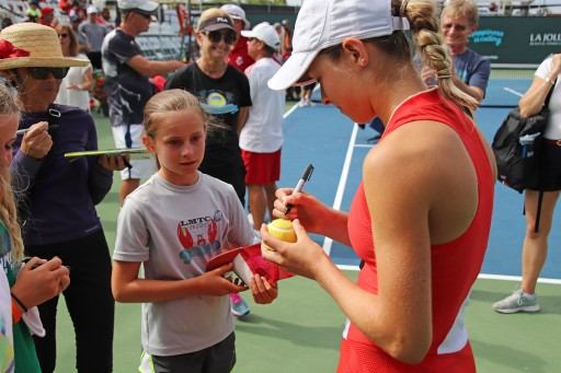 Katie Volynets signing autographs after winning Girl's 18 National Hard Court Championship.
