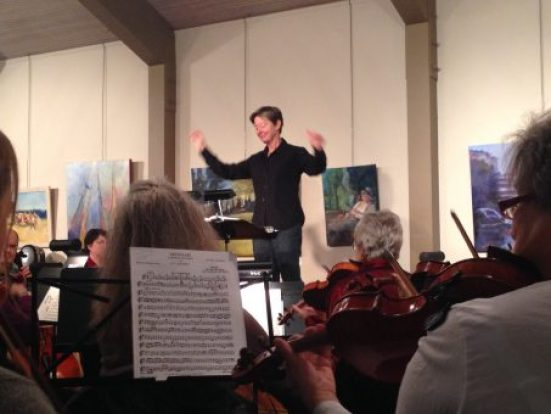Karen Thomas conducting, the Messiah - violinists in foreground