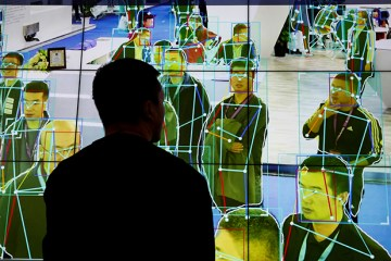 A man looks at a demonstration of human motion analysis software at the stall of the artificial intelligence solutions maker Horizon Robotics during the Security China 2018 exhibition on public safety and security in Beijing_ China October 24_ 2018.   REUTERS_Thomas Peter - RC1A9170A420