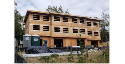 Three-story building under construction