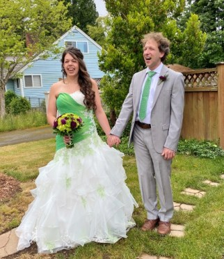 Nicole and Jacob Finkle, in wedding dress and suit
