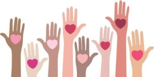 Raised hands of all different colors, each with a heart in the palm