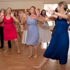 people dancing on wooden floor
