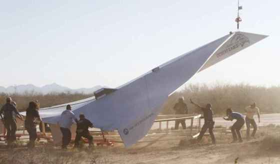 la-fi-tn-45-foot-paper-airplane-glides-over-ar-002