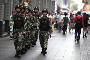 Paramilitary policemen patrol along a street in Shenzhen, Guangdong province, May 27, 2014. CREDIT: REUTERS/STRINGER