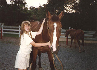 Photo of Jen Clark with a horse